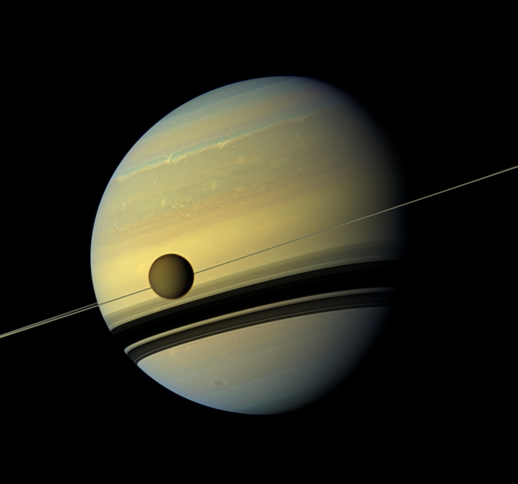 An incredible image of Saturn and its largest moon, Titan.