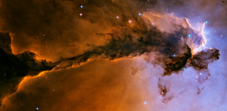 The stellar spire inside the Eagle Nebula. I've rotated it on its side, but would be seen vertically from Earth.